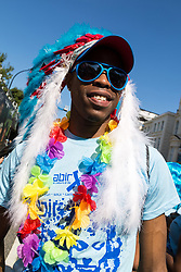 London, August 27 2017. Blue sky and warm temperatures greet revellers as Family Day of the Notting Hill Carnival gets underway. The Notting Hill Carnival is Europe's biggest street party held over two days of the bank holiday weekend, attracting over a million people. © Paul Davey.