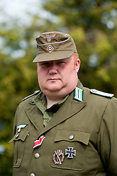 Reenactor dressed as an officer from the 21st Panzer division Afrika Korps at the Northallerton Wartime Weekend he is wearing the Iron Cross Second Class Medal Ribbon, Infantry Assault Badge and Iron Cross First class<br /> .18th and 19th June  2011<br /> Image © Paul David Drabble