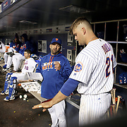 NEW YORK, NEW YORK - APRIL 27:  New York Mets batting coach Kevin Long, (left), talks with Lucas Duda #21 of the New York Mets in the dugout before his at bat during the New York Mets Vs Cincinnati Reds MLB regular season game at Citi Field on April 27, 2016 in New York City. (Photo by Tim Clayton/Corbis via Getty Images)