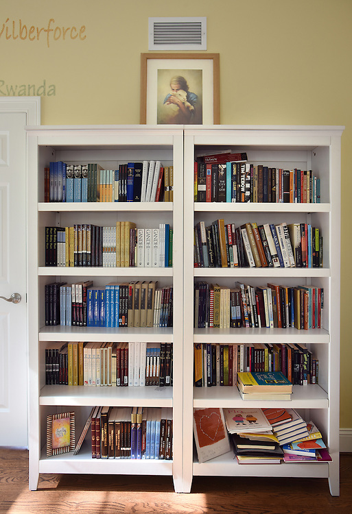 Mara Lavitt -- Special to the Hartford Courant<br /> March 7, 2016, Marlborough<br /> Pastor Nancy Butler's Marlborough bedroom with copies of the books of those who inspire her. Butler gives a book to everyone who visits her in her bedroom.