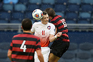 13 December 2015: Clemson's Aaron Jones (ENG) (11) and Stanford's Eric Verso (15) challenge for a header. The Clemson University Tigers played the Stanford University Cardinal at Sporting Park in Kansas City, Kansas in the 2015 NCAA Division I Men's College Cup championship match. Stanford won the game 4-0.