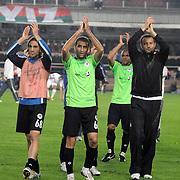 Konyaspor's Abdulvahit KARACABEY (C), Ferdi BOSODA (L) celebrate victory during their Play Off Second leg match at AliSamiYen Stadium in Istanbul Turkey on Thursday, 20 May 2010. Photo by TURKPIX