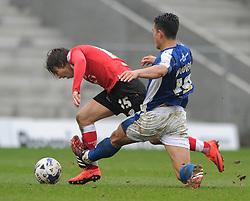 Bristol City's Luke Freeman challenges for the ball with Oldham Athletic's Luke Woodland - Photo mandatory by-line: Dougie Allward/JMP - Mobile: 07966 386802 - 03/04/2015 - SPORT - Football - Oldham - Boundary Park - Bristol City v Oldham Athletic - Sky Bet League One