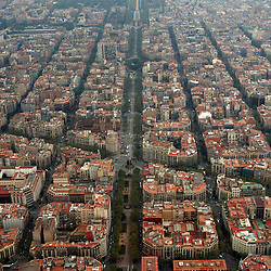 Aerial view of downtown Barcelona housing looking toward the mediterranean sea.