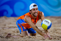 Emiel Boersma of Netherlands, the second team of the Netherlands was eliminated on the center court of the Chaoyang Park Beach Stadium on August 14, 2008 in Beijing