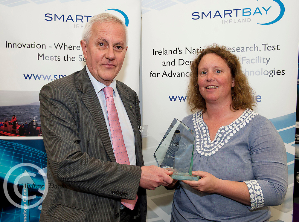 Pierre Eymery, Veolia presenting Charlotte O'Kelly TechWorks Marine with a SMARTBAY innovation award at the SmartOcean Innovation Exchange at the Volvo Global Village. Photo:Andrew Downes. Photo issued with Compliments no reproduction fee.