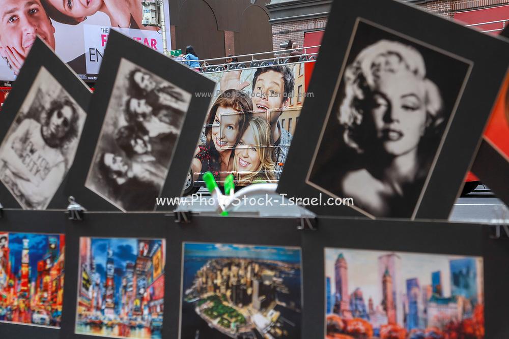 Souvenir postcards on display at a New York City postcard stand