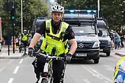 A City of London Police officer in front of police vans, seen near the Tower of London in London, England on September 05, 2018.