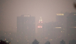 November 10, 2018 - Oakland, California, USA - Smoke blankets the Oakland Tribune Building in downtown Oakland on the evening of Nov. 10, 2018. Paul Kuroda/Zuma (Credit Image: © Paul Kuroda/ZUMA Wire)