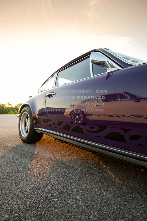 Image of a 1973 White Porsche RS lightweight reflecting in a 1973 Lilac Porsche RS touring in Lake of the Ozarks, Missouri, American Midwest by Randy Wells