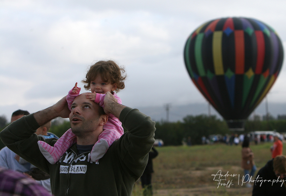 /Andrew Foulk/ For The Californian/.Jadeyn Jantzen, 14 months, sits on her father Doug's, shoulders as the two watch hot air balloons take to the air Saturday morning, during the 26th annual Temecula Balloon and Wine Festival.