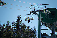 A lone skier approaches the top of the Panorama Lift at Gunstock on Friday afternoon. ©2021 Karen Bobotas Photographer