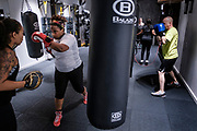 WASHINGTON, DC - NOVEMBER 14: Vermecia Alsop, 35, (second from left) of Washington, DC, participates in a boxing conditioning class at NUBOXX on Wednesday, November 14, 2018 in Washington, DC. Once a sweaty, gritty environment of men, the recent trend of fitness boxing is now all about brightly-lit studios and fresh millennial faces working the heavy or speed bag. (Photo by Pete Marovich For The Washington Post)