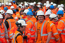 © Licensed to London News Pictures. 04/04/2014. Dawlish, Devon, UK. Engineers of 'The Orange'Army' wait for David Cameron. The Riviera Line railway linking Exeter, Plymouth and Penzance reopens two weeks ahead of schedule and two months after a sea wall was breached and a stretch of the line was badly damaged at Dawlish on February 4th 2014  by large waves and storms  which hit much of the British coastline on 4th February 2014. Photo credit : Graham M. Lawrence/LNP