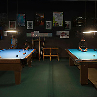 Asia Gillespie, 10, left, and Treyshawn Bia, 13, right, practice pool Tuesday evening at Q & A Billiards in Gallup. They are learning competitive billiards from Gina Kim, the owner of Q&A Billiards.