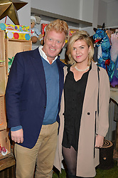 TOM ASTOR and MAISIE LITCHFIELD at a Fondue evening hosted by Rose van Cutsem and her brother Tom Astor to celebrate the new ski Season with leading ski resort Meribel, Besson Clothing and ESF ski schools at Maggie & Rose, 58 Pembroke Road, London on 7th November 2016.