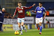 David Jones of Burnley (l) looks to get away from Kevin Bru of Ipswich Town. Skybet football league Championship match, Burnley v Ipswich Town at Turf Moor in Burnley, Lancs on Saturday 2nd January 2016.<br /> pic by Chris Stading, Andrew Orchard sports photography.