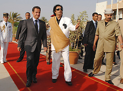 File photo - French President Nicolas Sarkozy is welcomed by Libyan leader Moammar Gadhafi upon his arrival in Tripoli, Libya on July 25, 2007. France and Libya on Wednesday signed a memorandum of understanding to build a Libyan nuclear reactor for water desalination and clinched a raft of other deals. Former French President Nicolas Sarkozy was in police custody on Tuesday morning March 20, 2018, an official in the country's judiciary said. He was to be questioned as part of an investigation into suspected irregularities over his election campaign financing, the same source added. The probe related to alleged Libyan funding for Sarkozy's 2007 campaign, Le Monde newspaper reported. Photo by Christophe Guibbaud/ABACAPRESS.COM