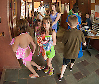 "Children coming back from the beach entering the Boys and Girls Club of the Lakes Region as they begin their first week in their new ""home"" on North Main Street in Laconia.  (Karen Bobotas/for the Laconia Daily Sun)"
