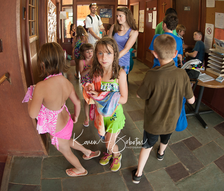 """Children coming back from the beach entering the Boys and Girls Club of the Lakes Region as they begin their first week in their new """"home"""" on North Main Street in Laconia.  (Karen Bobotas/for the Laconia Daily Sun)"""