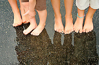 Bare feet on wet pavement