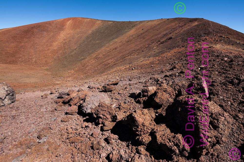Rim of a volcanic crater forms the summit of Mauna Kea. Mauna Kea Summit Trail leads all the way around the crater. Big Island, Hawaii, © David A. Ponton