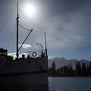 Steamer Wharf, Queenstown on the shores of Lake Wakatipu with the TSS Earnslaw steam ship moored and preparing to sail. Queenstown, New Zealand. 2nd January 2012