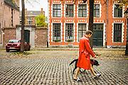 Ghent, Belgium, 23 oktober 2015, A woman is walking her dog at the begijnhofdries.