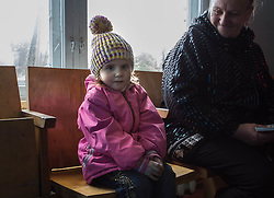 Diana Mescheryakova, 4 1/2, waits with her grandmother Alexandra Kravchenko, 62, to see an MSF doctor at the MSF mobile clinic run in the Bolshaya Vergunka polyclinic in Lugansk.