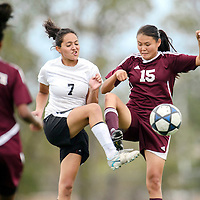 082614  Adron Gardner<br /> <br /> Gallup Bengal Danitza Zavala (7), left, and  Rehoboth Lynx Shannon Begay (15) tie up during a kick at Public School Stadium in Gallup Tuesday.