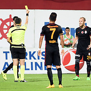 Referee Cuneyt Cakir (L) and Galatasaray's Semih Kaya (R) during their Turkish Super League Derby match Trabzonspor between Galatasaray at the Avni Aker Stadium at Trabzon Turkey on Saturday, 19 September 2015. Photo by TVPN/TURKPIX