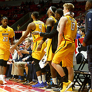 Willie Jackson high fives teammates while returning to his seat on the bench after fouling out during a college basketball team between Toledo and Ball State at Ball State University's Worthen Arena in Muncie, Ind., on Saturday, February 17, 2018. THE BLADE/KURT STEISS