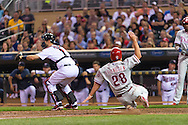 Kevin Frandsen #28 of the Philadelphia Phillies slides safely into home plate against the Minnesota Twins on June 11, 2013 at Target Field in Minneapolis, Minnesota.  The Twins defeated the Phillies 3 to 2.  Photo: Ben Krause