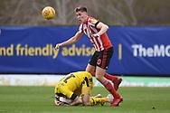 Sunderland defender Jimmy Dunne (30) fouls Oxford United forward Jamie Mackie (19) during the EFL Sky Bet League 1 match between Oxford United and Sunderland at the Kassam Stadium, Oxford, England on 9 February 2019.