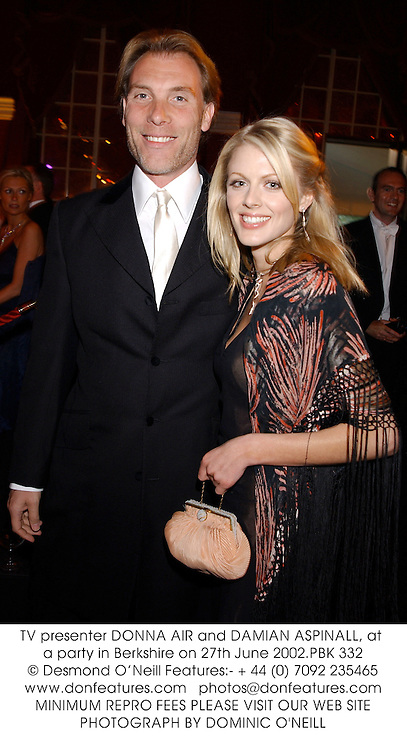 TV presenter DONNA AIR and DAMIAN ASPINALL, at a party in Berkshire on 27th June 2002.PBK 332