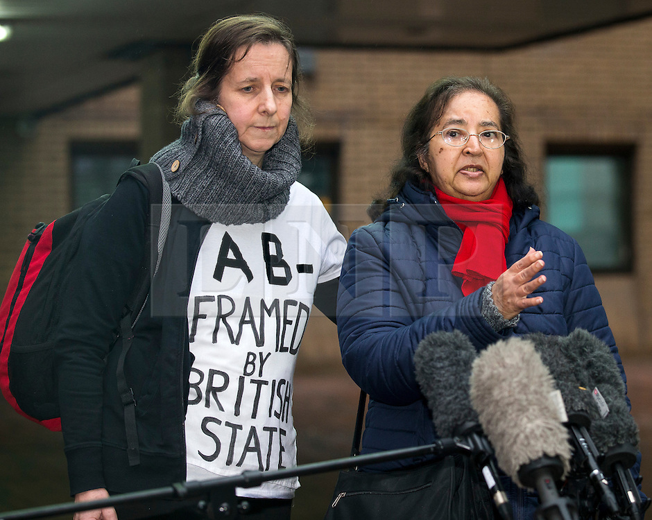 """© Licensed to London News Pictures. 29/01/2016. London, UK. JOSEPHINE HERIVEL (L) wearing a t-shirt with the words """"A B - FRAMED BY BRITISH STATE""""  written on it, stands next to CHANDRA BALAKRISHNA (R), the wife of Aravindan Balakrishnan as she speaks to media as they leave Southwark Crown Court in London where Maoist cult leader Aravindan Balakrishnan has been sentenced to 23 years in prison for rape, child cruelty and false imprisonment. Aravindan Balakrishnan was found guilty of the rape of two of his followers and and false imprisonment of  his daughter for more than 30 years in a commune in south London.  Photo credit: Peter Macdiarmid/LNP"""