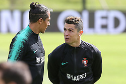 March 20, 2018 - Lisbon, Lisbon, Portugal - Portugal forward Cristiano Ronaldo (R) and Portugal defender Bruno Alves (L) during training session at Cidade do Futebol training camp in Oeiras, outskirts of Lisbon, on March 20, 2018 ahead of the friendly football match in Zurich against Egypt on March 23. (Credit Image: © Dpi/NurPhoto via ZUMA Press)