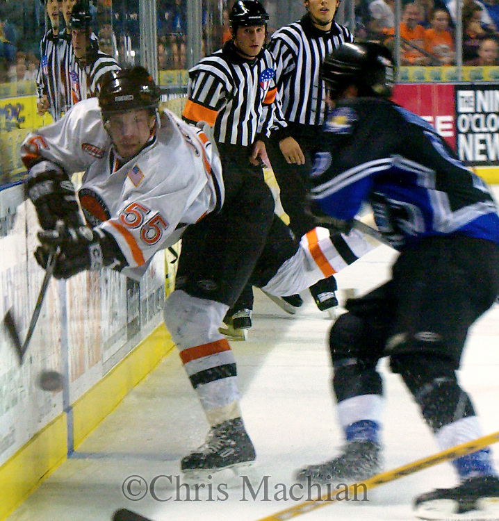 - Council Bluffs, IA. 4/25/2003 River City Lancers Janne Jokila flicks the puck down the ice during the first period .at the Mid America Center Friday evening (Chris Machian/Prairie Pixel Group)