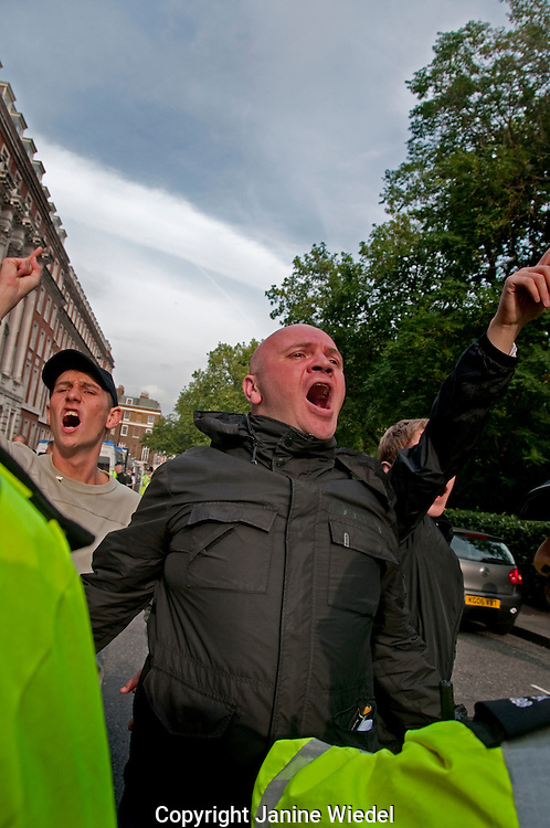 Members of Islamophobic right wing group The English Defense League  (EDL) disrupt a Muslim march
