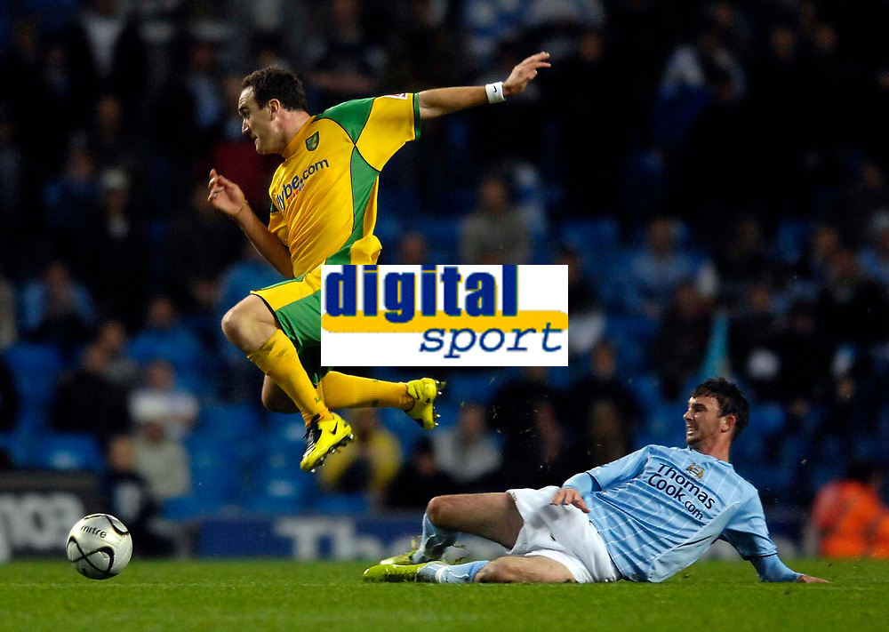 Photo: Jed Wee/Sportsbeat Images.<br /> Manchester City v Norwich City. Carling Cup. 25/09/2007.<br /> <br /> Norwich's Lee Croft (L) hurdles over a challenge from Manchester City's Stephen Ireland.