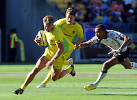 Australia's Lewis Holland is chased by Fiji's Ibai Tinai at the IRB International Rugby Sevens, Westpac, Wellington, New Zealand, Friday, February 01, 2013. Credit:SNPA / Ross Setford