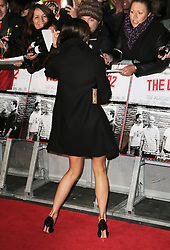 © Licensed to London News Pictures. Victoria Beckham signs autographs for fans as she attends The Class of 92  World Film Premiere at The Odeon West End, Leicester Square, London on 01 December 2013. Photo credit: Richard Goldschmidt/LNP
