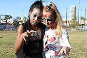 """Two HSPVA students show off their zombie looks before performing in a """"Thriller"""" flash mob outside the Metropolitan Multi-Services Center, where early voting was being held.<br /> To submit photos for inclusion in eNews, send them to hisdphotos@yahoo.com."""