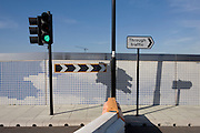 Incongruous traffic barrier and new 2012 Olympic street landscape near the Westfield City shopping complex, Stratford.