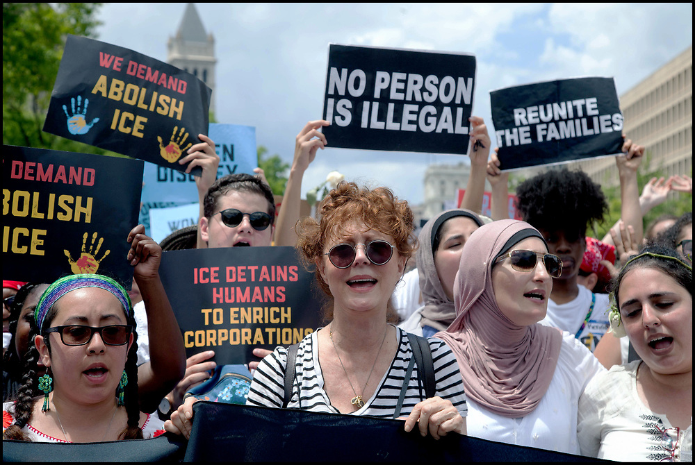 """Susan Sarandon joined Linda Sarsour, on June 28, 2018, as more than one thousand women from all over the US marched from the Freedom Plaza in Washington, DC, to Capitol Hill for a peaceful protest and sit-in at The Hart Senate Office Building over the Trump administration's """"zero tolerance"""" immigration policy which called for separating children from their parents. At least 575 women were arrested."""
