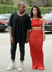 "File photo of Kanye West and Kim Kardashian attend the RocNation Pre-Grammy Brunch in Beverly Hills, Los Angeles, CA, USA on February 7 2015. Kim Kardashian West spoke out about Kanye West's bipolar disorder Wednesday, three days after the rapper delivered a lengthy monologue at a campaign event touching on topics from abortion to Harriet Tubman, and after he said he has been trying to divorce her.Kardashian West said in a statement posted in an Instagram Story that she has never spoken publicly about how West's bipolar disorder has affected their family because she is very protective of their children and her husband's ""right to privacy when it comes to his health."" Photo by Lionel Hahn/ABACAPRESS.COM"