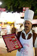 Mcc0028781 . Daily Telegraph..Travel..Advertising on for food stall on Chowpatti beach...Mumbai street food..Mumbai January 2011..