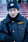 Portrait of a young soldier in the streets of Yakutsk. Yakutsk is a city in the Russian Far East, located about 4 degrees (450 kilometres) south of the Arctic Circle. It is the capital of the Sakha (Yakutia) Republic in Russia with a major port on the Lena River. The city has a population of 264.000 (2009). Yakutsk is one of the coldest cities on Earth. The average monthly winter temperature in January is around -43,2 C. Yakutsk, Jakutsk, Yakutia, Russian Federation, Russia, RUS, 15.01.2010.