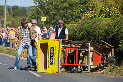 Cookham Dean, UK. 1 September, 2019. A custom-built kart in the form of Trotter's Independent Trading Reliant Regal van from the TV series 'Only Fools and Horses' crashes during the Cookham Dean Gravity Grand Prix in aid of the Thames Valley and Chiltern Air Ambulance.