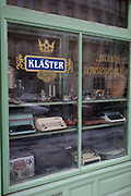 Old typewriters and recording equipment in the window of a corner shop in Letna, Holesovic districte, Prague 7, on 18th March, 2018, in Prague, the Czech Republic.